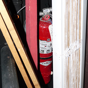 Fire-Extinguisher-Hidden-Behind-Junk-(Small).png